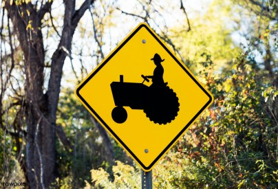 Road sign of slow moving tractor in Holmes County, Ohio. Origina